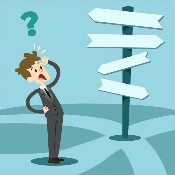 Imagen de una persona ante varias señales de dirección y no sabiendo hacia dónde ir.